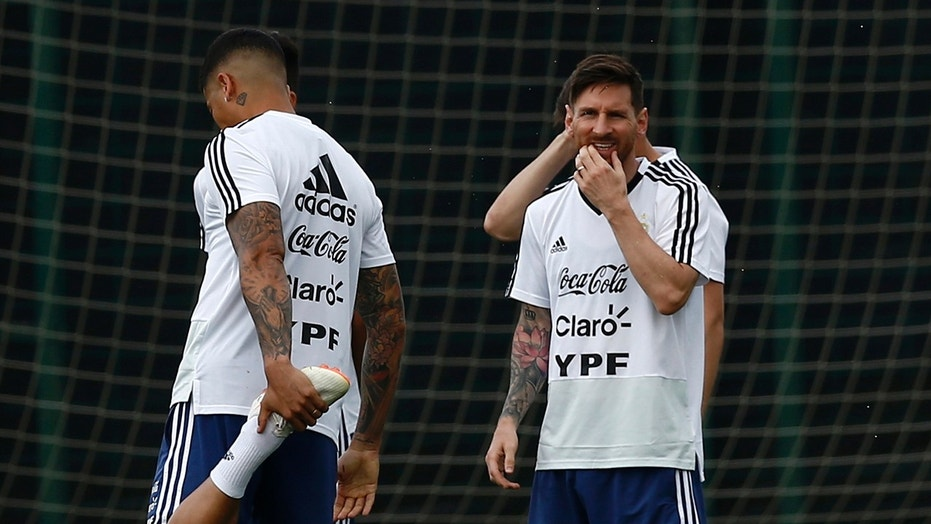 Argentina's Lionel Messi, right, attends a team training session at the Sports Center FC Barcelona Joan Gamper, in Sant Joan Despi, Spain.