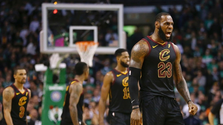 Cleveland Cavaliers forward LeBron James, right, celebrates a basket during the second half in Game 7 of the NBA basketball Eastern Conference finals against the Boston Celtics, Sunday, May 27, 2018.