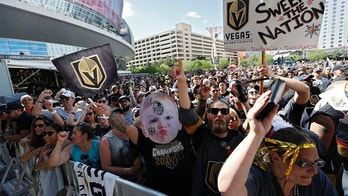 Fans gather outside T-Mobile Arena prior to Game 1 of the NHL hockey Stanley Cup Finals between the Vegas Golden Knights and the Washington Capitals, Monday, May 28, 2018, in Las Vegas. (AP Photo/John Locher)