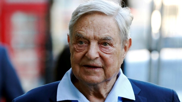 Business magnate George Soros arrives to speak at the Open Russia Club in London Britain
