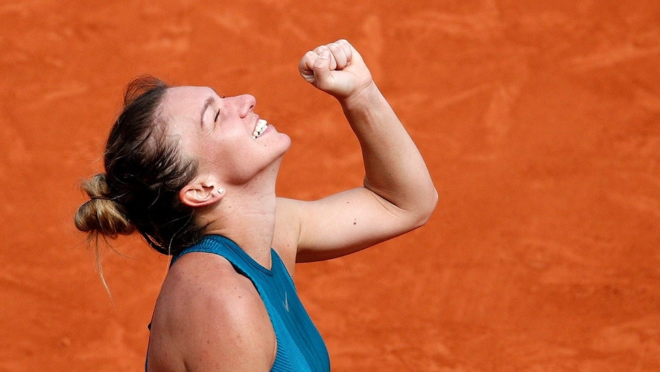 Romania's Simona Halep clenches her fist after defeating Sloane Stephens of the U.S. during their final match of the French Open tennis tournament at the Roland Garros stadium, Saturday, June 9, 2018 in Paris. Halep won 3-6, 6-4, 6-1. (AP Photo/Christophe Ena)