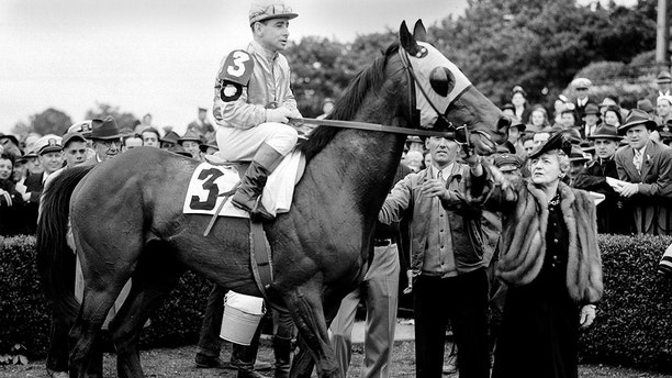 Jockey Johnny Longden is seated on Count Fleet in New York on May 22, 1943. Longden rode Count Fleet to thoroughbred racing's Triple Crown, with victories in the Kentucky Derby, Preakness and Belmont Stakes. (AP Photo)