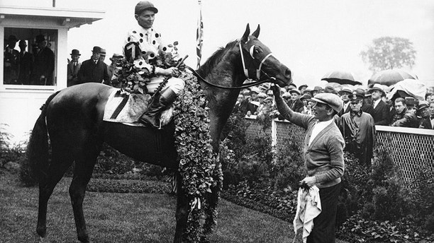 "Famous jockey ""The Earl of Sande"" up on his third Kentucky Derby winner Gallant Fox after the finish of the classic at Churchill Downs, Kentucky on May 19, 1930. (AP Photo)"