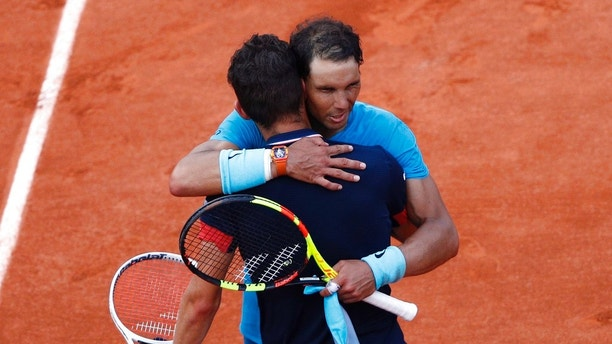 Spain's Rafael Nadal, right, hugs Austria's Dominic Thiem after the men's final match of the French Open tennis tournament at the Roland Garros stadium, Sunday, June 10, 2018 in Paris. Nadal won 6-4, 6-3, 6-2. (AP Photo/Christophe Ena)