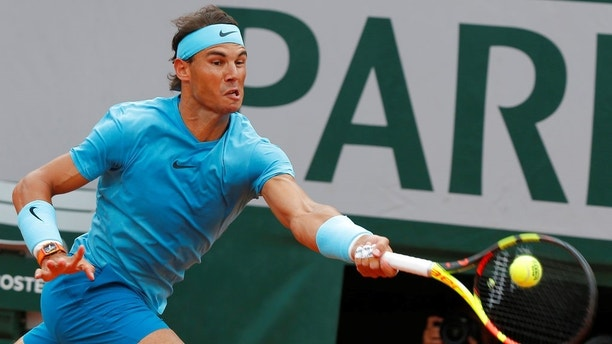 Spain's Rafael Nadal plays a shot against Austria's Dominic Thiem in the men's final match of the French Open tennis tournament at the Roland Garros stadium in Paris, France, Sunday, June 10, 2018. (AP Photo/Michel Euler)