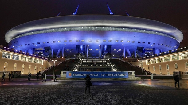 FILE - In this Monday, Feb. 11, 2017 filer, a view of the new soccer stadium on Krestovsky Island which will host some 2018 World Cup matches in St. Petersburg, Russia. (AP Photo/Dmitri Lovetsky, File)