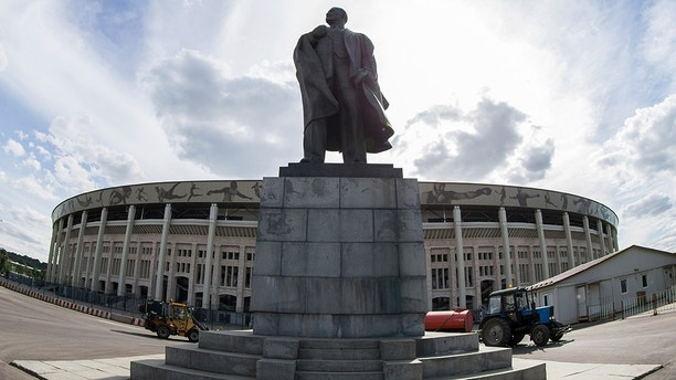 In this photo taken on Wednesday, June 28, 2017 the statue of Soviet founder stands in front of the Luzhniki stadium entrance in Moscow. (AP Photo/Denis Tyrin)