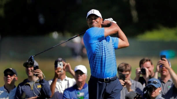 Tiger Woods tees off the 8th hole during a practice round for the U.S. Open Golf Championship, Tuesday, June 12, 2018, in Southampton, N.Y. (AP Photo/Julie Jacobson)