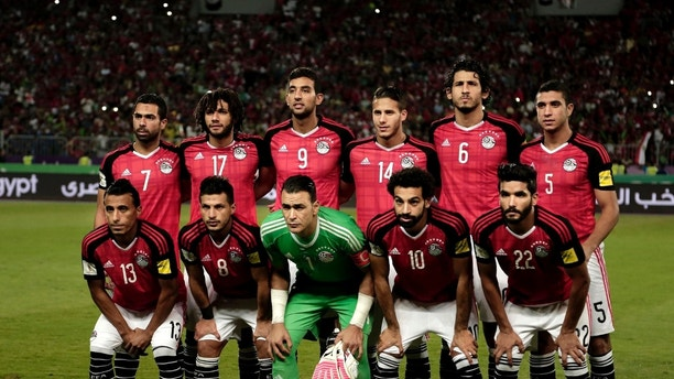 FILE - In this Sunday, Oct. 8, 2017 filer Egypt's national football team pose for a photograph ahead of the 2018 World Cup group E qualifying soccer match between Egypt and Congo at the Borg El Arab Stadium in Alexandria, Egypt. (AP Photo/Nariman El-Mofty)