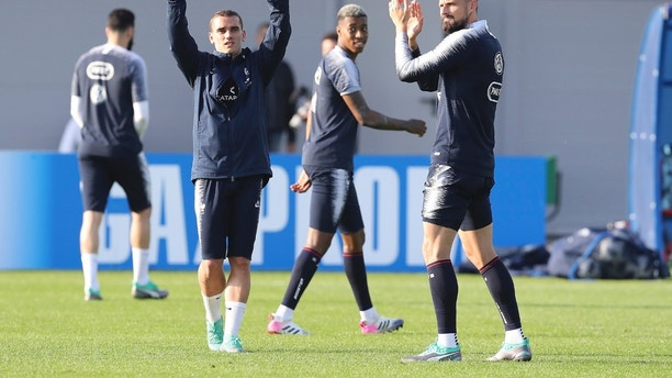 France's Antoine Griezmann and Oliver Giroud salute their supporters at the end of a training session at the 2018 soccer World Cup in Glebovets, Russia, Tuesday, June 12, 2018. (AP Photo/David Vincent)