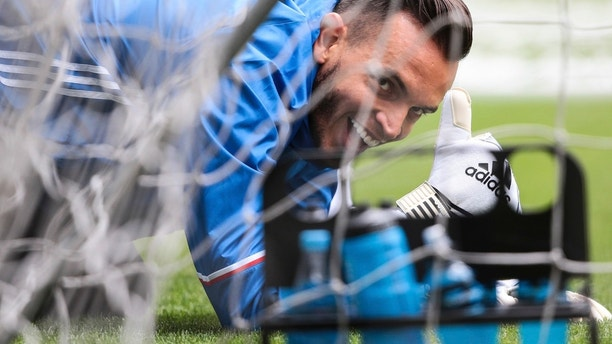 FILE In this file photo taken on Monday, June 19, 2017, Russia goalkeeper Guilherme Marinato poses for a photo during a training session at the VEB Arena stadium in Moscow, Russia. Russian national team goalkeeper Guilherme Marinato, a naturalized citizen who was born in Brazil, was twice targeted by Spartak fans calling him a monkey. (AP Photo/Denis Tyrin)