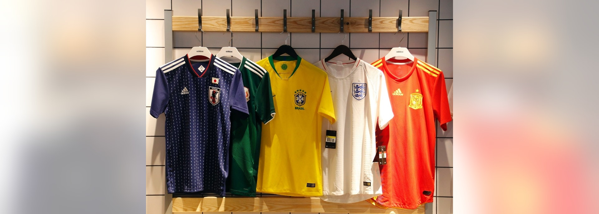 In this June 5, 2018 photo national soccer team jerseys of Japan, from left, Mexico, Brazil, England and Spain are on display at a shop in London. With just days to go before the FIFA World Cup, some winners and losers have emerged among the often wild and wacky team jerseys. (AP Photo/Frank Augstein)