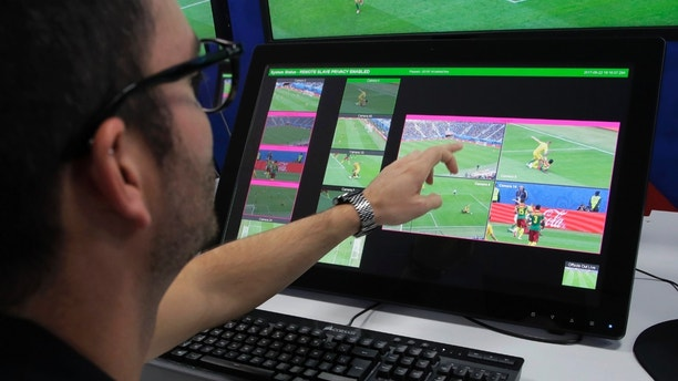 A referee demonstrates a video operation room (VOR), a facility of the Video Assistant Referee (VAR) system which will be rolled out for the first time during the World Cup, at the 2018 World Cup International Broadcast Centre in Moscow, Russia, Saturday, June 9, 2018. (AP Photo/Dmitri Lovetsky)