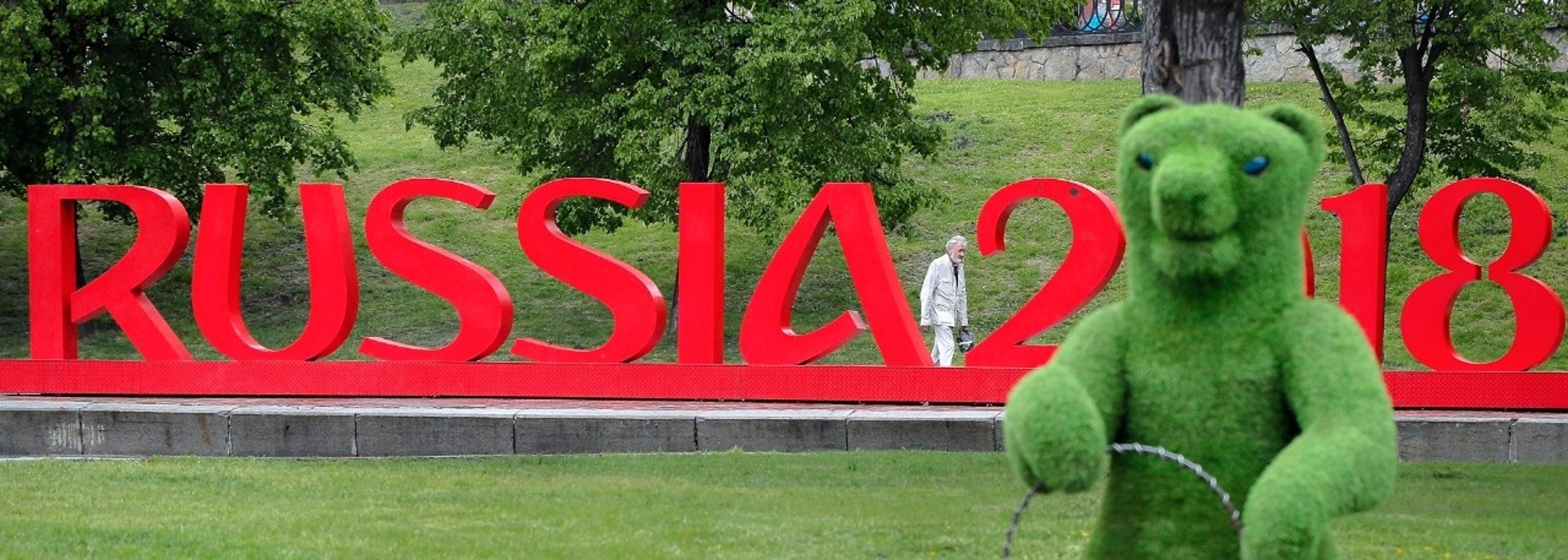 A man walks past a World Cup sign near the fan zone during the 2018 soccer World Cup in Yekaterinburg, Russia, Wednesday, June 13, 2018. (AP Photo/Vadim Ghirda)
