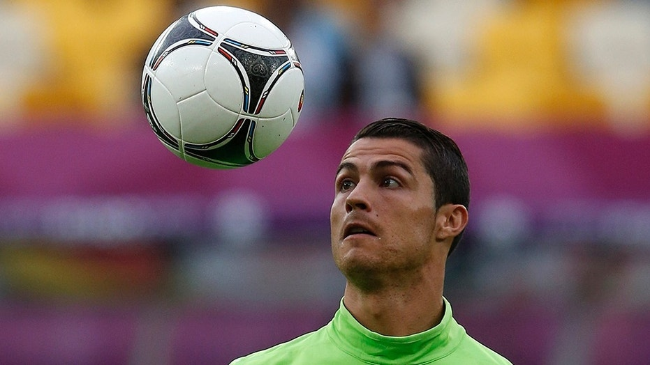 Portugal's Cristiano Ronaldo watches the ball at a training session during the Euro 2012 at Arena Lviv in Lviv June 8, 2012.