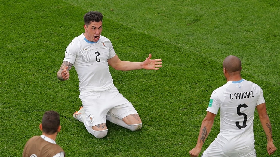 Uruguay's Jose Gimenez, left, celebrates with his teammate Carlos Sanchez after scoring the opening goal during the group A match between Egypt and Uruguay at the 2018 soccer World Cup in the Yekaterinburg Arena in Yekaterinburg, Russia.