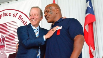 International Boxing Hall of Fame Class of 2018 inductee Jim Gray shares a moment with Mike Tyson during the IBHOF Induction ceremony on Sunday, June 10, 2018, in Canastota, New York. (John Brewer/Oneida Daily Dispatch via AP)
