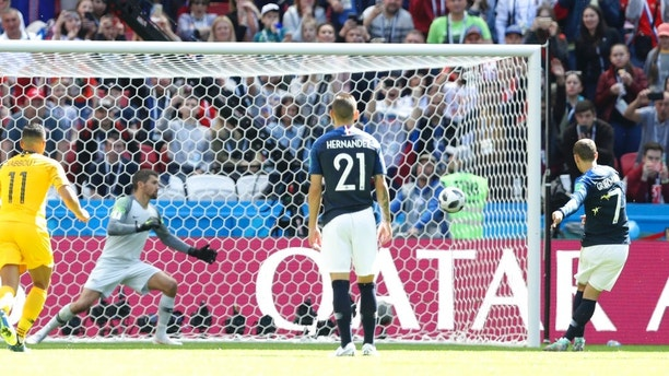 France's Antoine Griezmann scores the opening goal from the penalty spot during the group C match between France and Australia at the 2018 soccer World Cup in the Kazan Arena in Kazan, Russia, Saturday, June 16, 2018. (AP Photo/David Vincent)