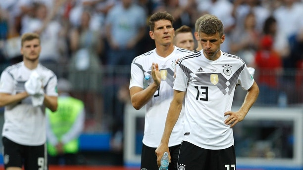 Germany's Thomas Mueller, right, reacts at the end of the group F match between Germany and Mexico at the 2018 soccer World Cup in the Luzhniki Stadium in Moscow, Russia, Sunday, June 17, 2018. (AP Photo/Victor R. Caivano)