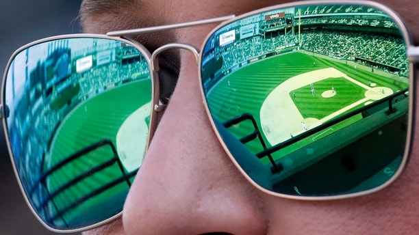 Courtney Wheaton watches a baseball game between the Detroit Tigers and the Chicago White Sox in Chicago, Sunday, June 17, 2018. (AP Photo/Nam Y. Huh)