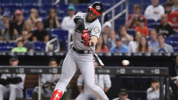 Washington Nationals' Bryce Harper strikes out swinging during the first inning of a baseball game against the Miami Marlins, Saturday, May 26, 2018, in Miami. (AP Photo/Lynne Sladky)