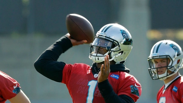 Carolina Panthers' Cam Newton (1) throws a pass during the NFL football team's practice in Charlotte, N.C., Wednesday, June 13, 2018. (AP Photo/Chuck Burton)