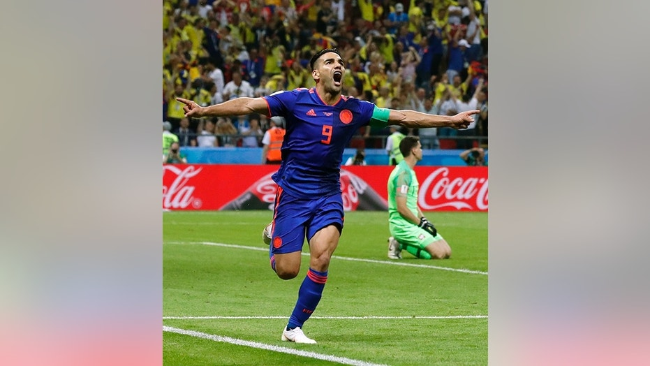Radamel Falcao celebrates after putting Colombia 2-0 up over Poland in Sunday's Group H match in Kazan, Russia.