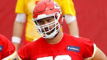 Kansas City Chiefs offensive tackles Cameron Erving (75), Jordan Devey (65) and Laurent Duvernay-Tardif (76) stretch during the NFL football team's practice Tuesday, June 12, 2018, in Kansas City, Mo. (AP Photo/Charlie Riedel)