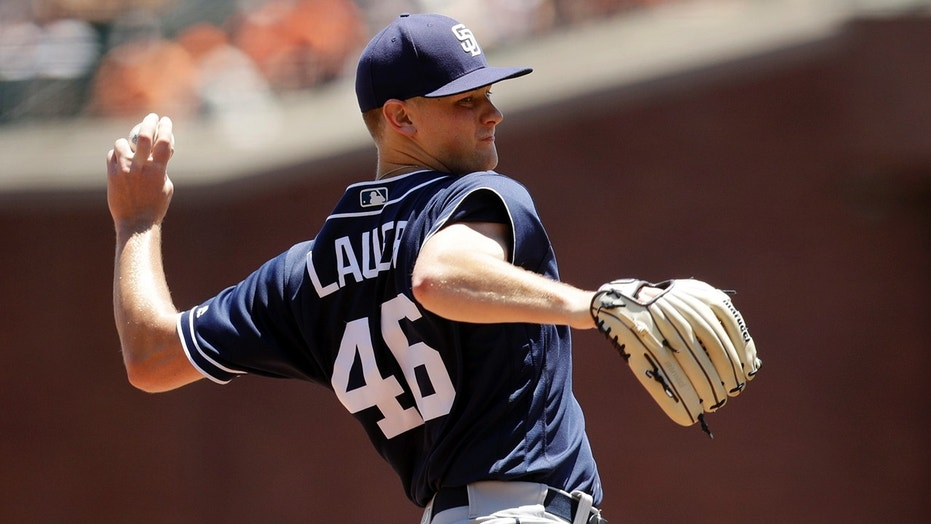 San Diego Padres starting pitcher Eric Lauer throws to the San Francisco Giants during the first inning a baseball game.