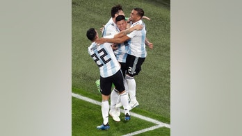 Argentina's Marcos Rojo, center, celebrates with teammate Lionel Messi after scoring his side's second goal during the group D match between Argentina and Nigeria, at the 2018 soccer World Cup in the St. Petersburg Stadium in St. Petersburg, Russia, Tuesday, June 26, 2018. (AP Photo/Michael Sohn)