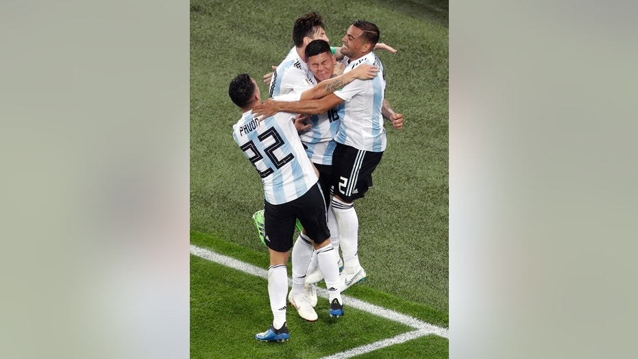 Argentina celebrate Marcus Rojo's match-winning goal in the 86th minute of their game against Nigeria in St. Petersburg.