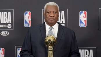 """Oscar """"The Big O"""" Robertson poses in the press room with the lifetime achievement award at the NBA Awards on Monday, June 25, 2018, at the Barker Hangar in Santa Monica, Calif. (Photo by Richard Shotwell/Invision/AP)"""