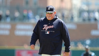 Detroit Tigers pitching coach Chris Bosio walks to the dugout during the seventh inning of game one of a baseball doubleheader against the Kansas City Royals, Friday, April 20, 2018, in Detroit. (AP Photo/Carlos Osorio)