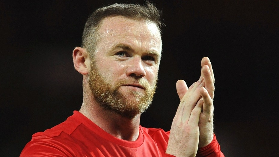 In this Nov. 27, 2016, file photo, Manchester United's Wayne Rooney applauds fans after an English Premier League soccer match against West Ham United in Manchester, England.