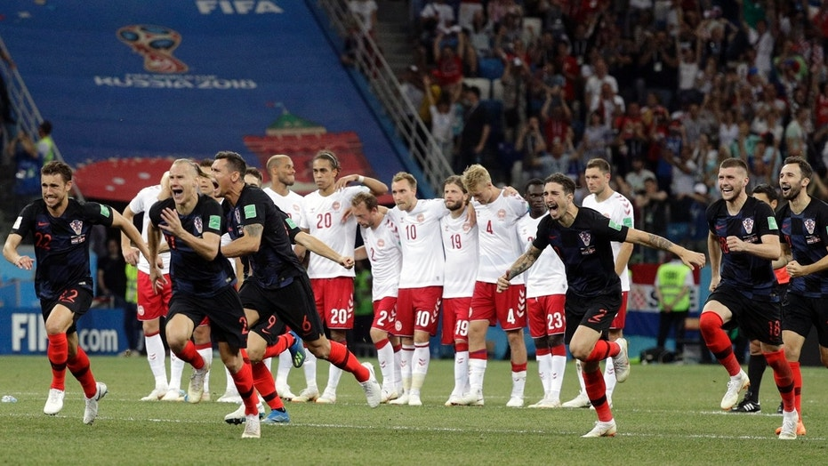 Croatia players run toward goalkeeper Danijel Subasic (not pictured) after the penalty shootout against Denmark.