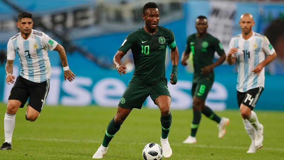 Nigeria captain John Obi Mikel controls the ball during a match against Argentina.