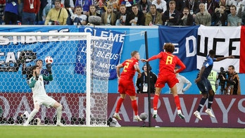 France's Samuel Umtiti, right, scores his side's opening goal during the semifinal match between France and Belgium at the 2018 soccer World Cup in the St. Petersburg Stadium, in St. Petersburg, Russia, Tuesday, July 10, 2018. (AP Photo/David Vincent)