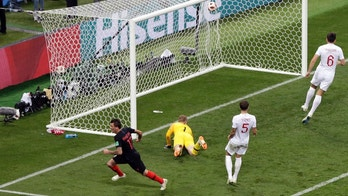 Croatia's Mario Mandzukic, left, celebrates after scoring his side's second goal during the semifinal match between Croatia and England at the 2018 soccer World Cup in the Luzhniki Stadium in Moscow, Russia, Wednesday, July 11, 2018. (AP Photo/Thanassis Stavrakis)
