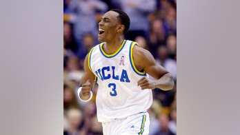 FILE - In this Dec. 29, 2001, file photo, UCLA's Billy Knight celebrates after scoring his second 3-point basket against Georgetown during the first half of an NCAA college basketball game in Los Angeles. Knight has died in Phoenix and the Maricopa County Medical Examiner's Office is trying to determine the cause of death. Phoenix police say Knight's body was found on a roadway early Sunday, July 8, 2018, near the downtown area and there was no evidence of foul play. The 39-year-old Knight was a guard/forward at UCLA from 1998-2002, averaging 14.1 points and 3.5 rebounds per game as a senior. (AP Photo/Kevork Djansezian, File)