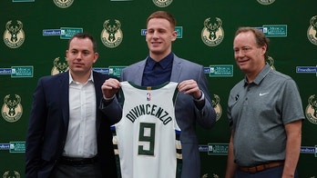 Milwaukee Bucks NBA basketball team first-round draft pick Donte DiVincenzo poses for a picture with head coach Mike Budenholzer, right, and general manager Jon Horst at a news conference Monday, June 25, 2018, in Milwaukee. (AP Photo/Morry Gash)