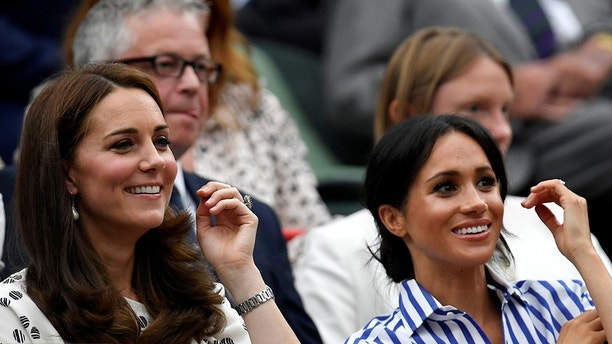 Tennis - Wimbledon - All England Lawn Tennis and Croquet Club, London, Britain - July 14, 2018. Britain's Catherine the Duchess of Cambridge and Meghan the Duchess of Sussex arrive to watch Spain's Rafael Nadal continue his semi final match against Serbia's Novak Djokovic, which was suspended yesterday, after running late.    REUTERS/Toby Melville     TPX IMAGES OF THE DAY - RC1F88915310