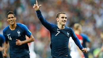 France's Antoine Griezmann celebrates after scoring on a penalty his side' second goal during the final match between France and Croatia at the 2018 soccer World Cup in the Luzhniki Stadium in Moscow, Russia, Sunday, July 15, 2018. (AP Photo/Matthias Schrader)