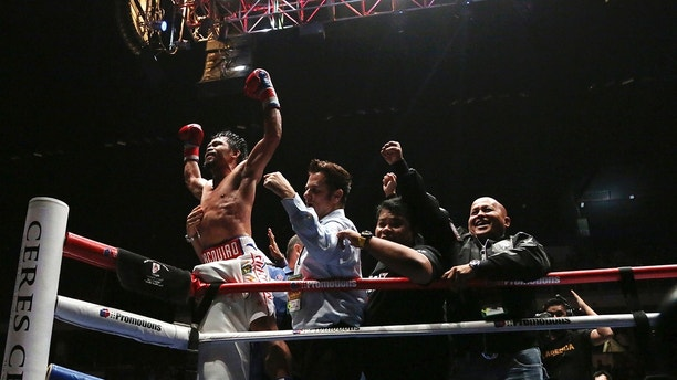 Philippines boxer Manny Pacquiao celebrates after defeating Argentina Lucas Matthysse during their WBA World welterweight title bout in Kuala Lumpur, Malaysia, Sunday, July 15, 2018. Pacquiao won the WBA welterweight world title after knocking out Matthysse on round seven. (AP Photo/Yam G-Jun)