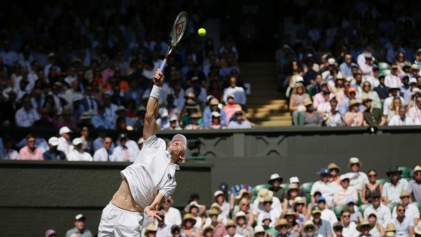 Kevin Anderson of South Africa serves to Novak Djokovic of Serbia during the men's singles final match at the Wimbledon Tennis Championships in London, Sunday July 15, 2018. (AP Photo/Tim Ireland, Pool)