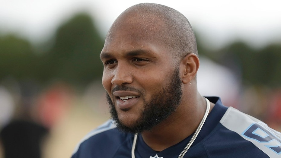 Tennessee Titans' defensive end Jurrell Casey gives a television interview during an NFL flag schools event at King's House Sports Ground in Chiswick, west London on Wednesday.