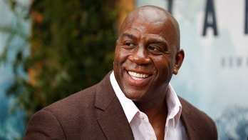 """Former NBA basketball player Earvin Magic Johnson poses at the premiere of the movie """"The Legend of Tarzan"""" in Hollywood, California, June 27, 2016. REUTERS/Danny Moloshok - S1AETMKZFGAA"""