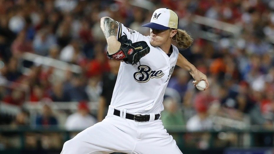 Milwaukee Brewers reliever Josh Hader on Saturday was greeted with a standing ovation by his fans as he emerged for the first time since his homophobic and racist tweets from seven years ago were revealed last week.