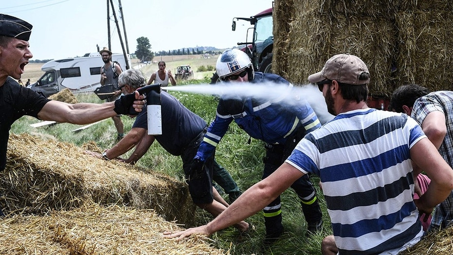 Tour de France riders sprayed with tear gas amid protest by farmers
