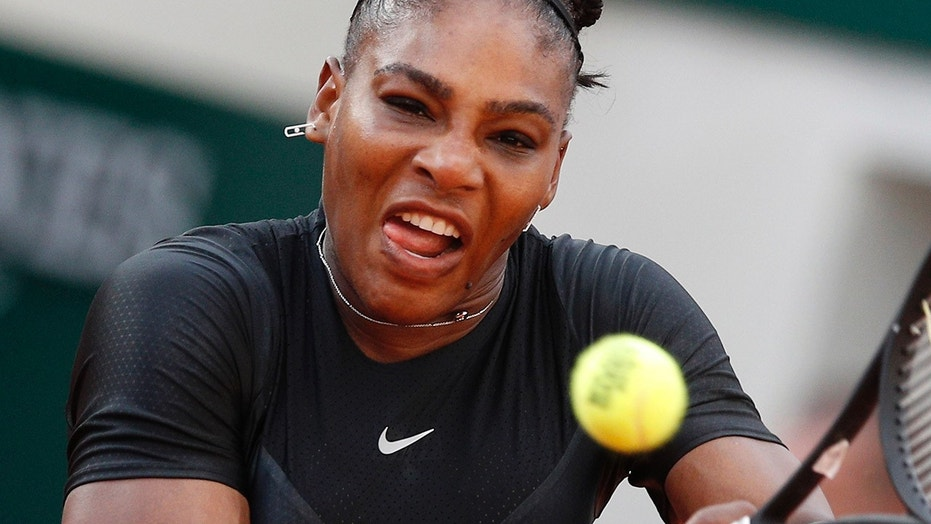 Serena Williams of the U.S. returns a shot against Germany's Julia Georges during their third-round match of the French Open tennis tournament at the Roland Garros stadium in Paris, France, June 2, 2018.