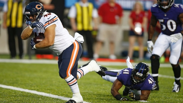 Chicago Bears fullback Michael Burton, left, scores against the Baltimore Ravens on a pass reception during the first half at the Pro Football Hall of Fame NFL preseason game Thursday, Aug. 2, 2018, in Canton, Ohio. (AP Photo/Ron Schwane)
